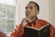 Man holding Holy Bible